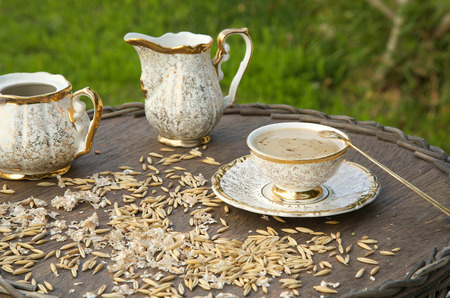 substitute: Healthy breakfast drink: coffee substitute barley drink.Barley grains and flakes in the background. Stock Photo