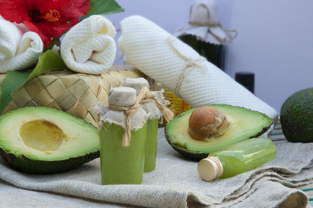Body scrub with avocado oil. Spa products in the background.