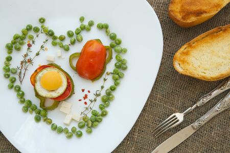 grilled vegetables: Low-calorie lunch: grilled vegetables with egg,cheese and thyme twig on a white plate