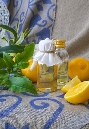 relaxant: A bottle of bergamot oil. Bergamot fruits in the background. Stock Photo