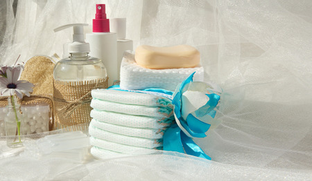 antiseptic: Hygiene set for a baby: liquid soap,cotton sticks,shower,diapers,cosmetic discs,soap,gel,lotion,antiseptic,physiological liquid.Free space for a text Stock Photo