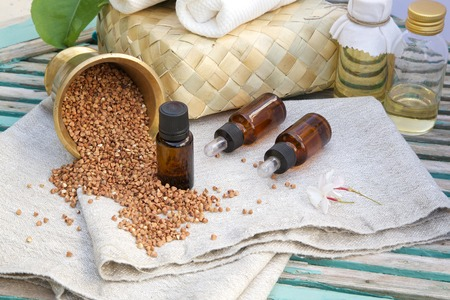 lysine: A dropper bottle of bioactive buckwheat oil on a sackcloth