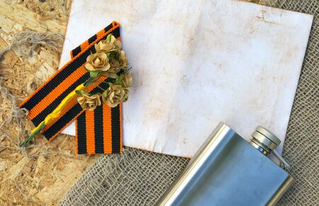 hip flask: Saint George ribbon,hip flask,paper roses, and free space for a text. Background