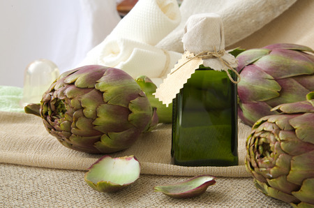 gallstones: A glass bottle of artichoke oil on a sackcloth Stock Photo