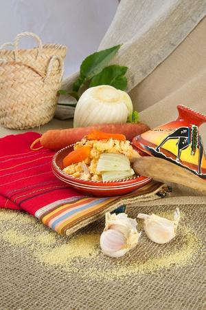 berber: Traditional berber dish of semolina - couscous in the tagine.