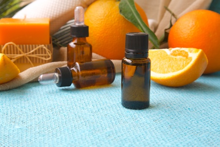 limonene: A dropper bottle of sweet orange essential oil. Oranges in the background Stock Photo
