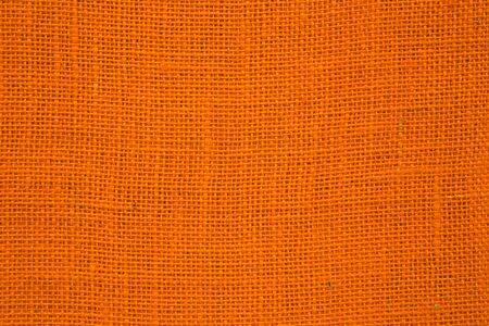 sackcloth: Orange decorative sackcloth - background.