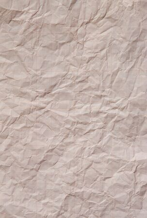 distressed paper: A piece of jammed and distressed graph paper. Background Stock Photo