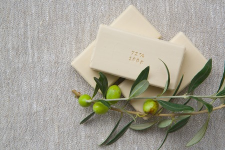 text free space: Soap bars with olive oil and olive tree twigs. Free space for a text