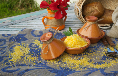 colorectal cancer: Boiled corn cereal in tajine. Raw corn cereal,whole grain bread,hibiscus flower in the background
