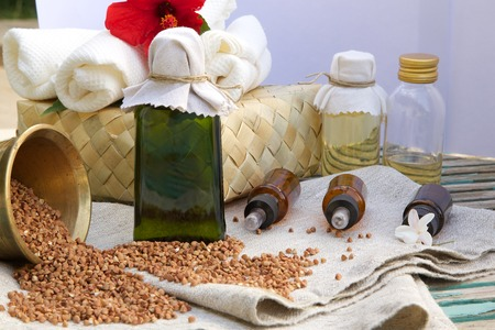 lysine: A glass bottle of buckwheat oil on a sackcloth Stock Photo