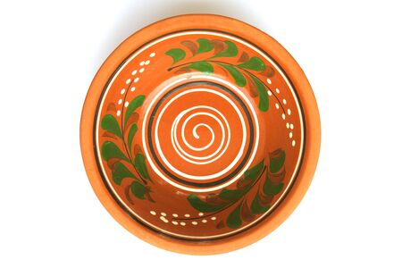 over white: Handmade clay dish in Moldovan tradition. Isolated over white