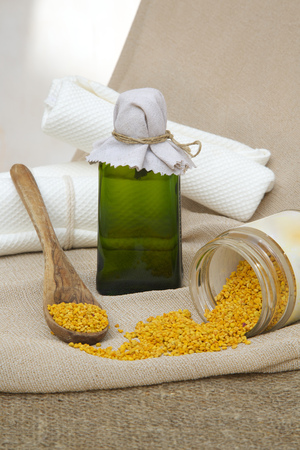 propolis: A glass bottle of bee propolis oil. Bee propolis grains in the background. Stock Photo