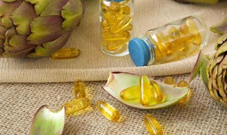 gallstones: Artichoke oil softgels on a sackcloth