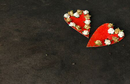 sexual relations: Two handmade hearts decorated with paper roses Stock Photo