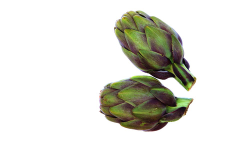 copyspace: Two violet artichokes. Isolated over white. Copyspace
