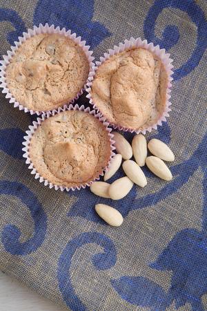 dark blue: Homemade almond sponge cakes without flour on a dark blue sackcloth Stock Photo