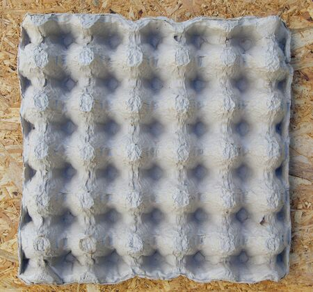 egg carton: Egg carton box on a wooden surface. Top view.Background Stock Photo