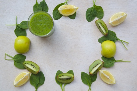 text free space: Detox green smoothie ingredients: kiwi, green apple,spinach,lemon - background. Free space for a text. Stock Photo