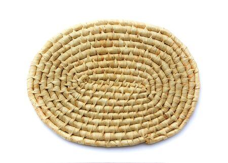 trivet: Oval woven trivet. Isolated over white