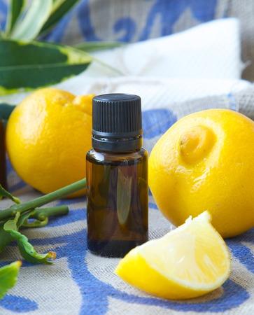 relaxant: A dropper bottle of bergamot essential oil. Bergamot in the background. Stock Photo