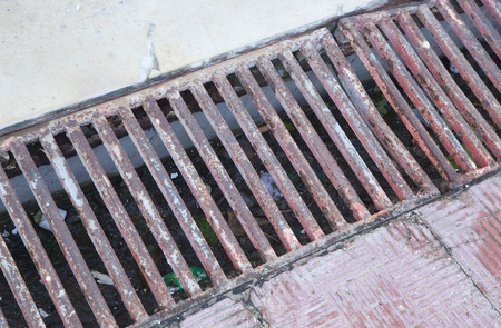 clogged: Clogged up street drain with rubbish. Stock Photo