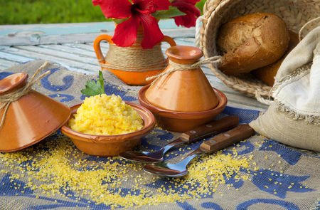 hemorrhoid: Boiled corn cereal in tajine. Raw corn cereal,whole grain bread,hibiscus flower in the background