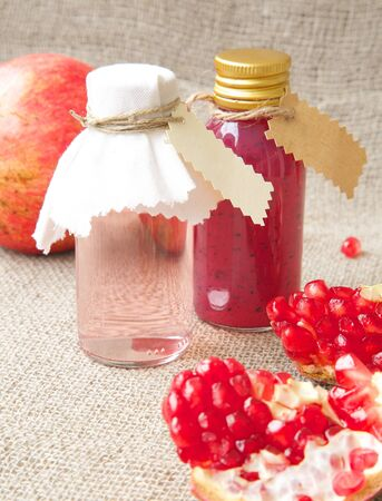 hormonal: Shampoo with pomegranate oil. Free space for a text Stock Photo