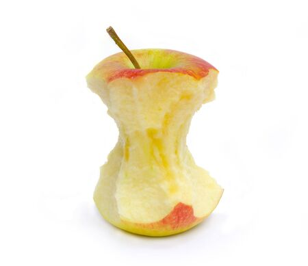 consummation: An apple core on a white surface