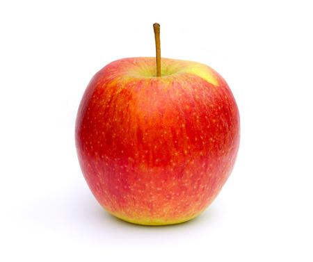 白い表面に黄色赤いリンゴ