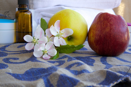 ascorbic acid: Apple blossoms.Apples and dropper bottles in the background