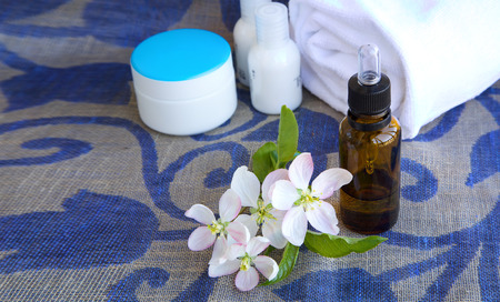 colorectal cancer: Apple blossoms extract in a glass bottle. Closeup