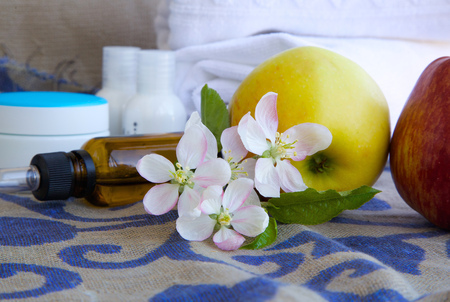 colorectal cancer: Apple blossoms.Apples and dropper bottles in the background