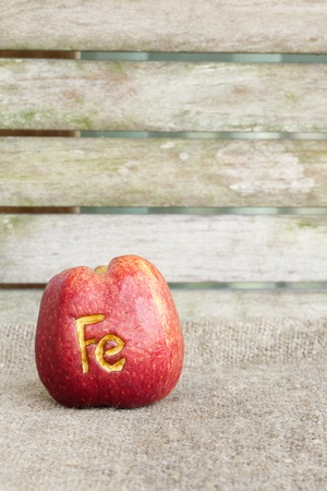 colorectal cancer: Abbreviation Fe  scratched on an apple skin. Close up