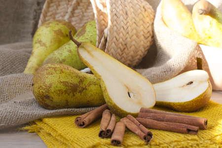 carotenoid: Pears on a yellow decorative sackcloth and cinnamon sticks
