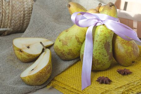 carotenoid: Pears and star anise on a sackcloth