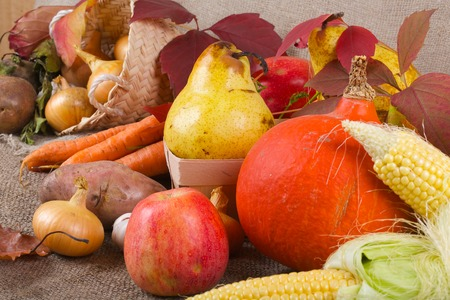 Abundance of fruits and vegetables on a grey sackcloth. Stock Photo