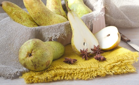 carotenoid: Pears on a yellow decorative sackcloth and star anise