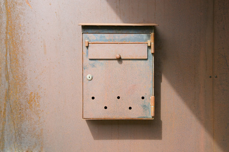 rusted: Rusted rectangular post box.Background