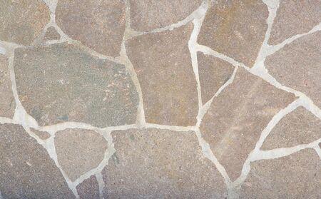 Stone cladding wall. Background