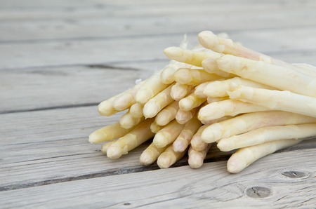 anti ageing: White asparagus on an old wooden surface.Free space for a text. Close up