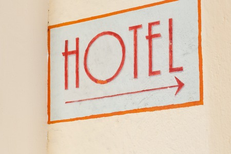 indication: Indication for hotel at the wall of a building.