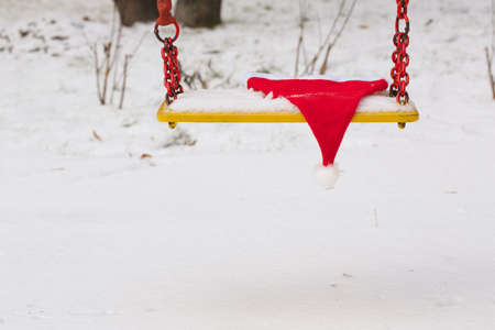 swing seat: The hat of santa claus on a swing seat Stock Photo