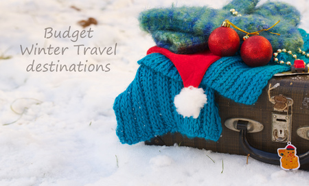 winter vacation: Winter vacation suitcase.Budget winter travel destinationsl.