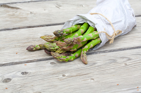 diuretic: Green asparagus on a wooden surface, just brought from the market.