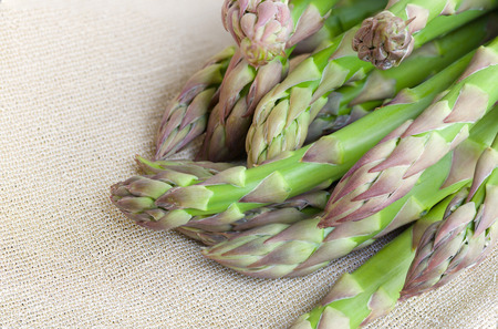 anti ageing: Green asparagus, just brought from the market.Sackcloth as a background Stock Photo