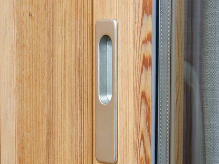 sliding door: Doorknob of an exterior sliding door Stock Photo