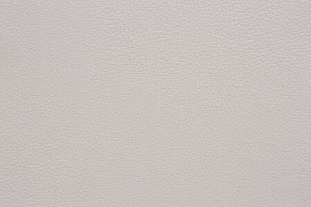 faux: Beige coloured faux leather surface