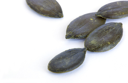 cystitis: Peeled pumpkin seeds.Closeup.Isolated over white.