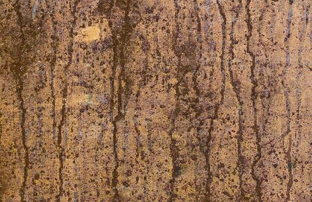 original idea: Flows of brown dye on a golden-coloured surface. Background